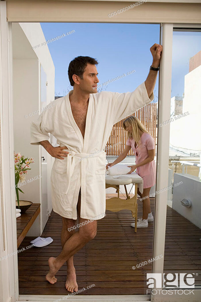 Stock Photo: Man standing on porch in his bathrobe.