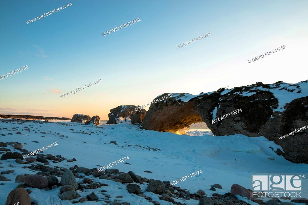Stock Photo: Sunset Through the Arches, Lime Stone rock formation, the Arches Provincial Park, Great Northern Peninsula, Newfoundland and Labrador.