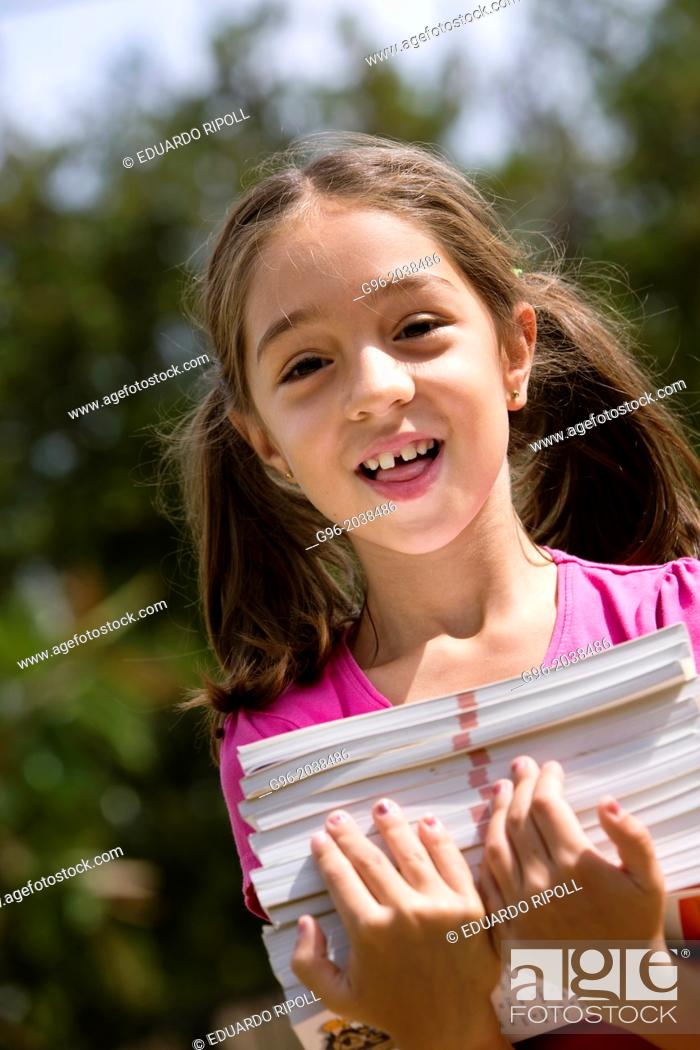 Stock Photo: Little girl carries a lot of books.