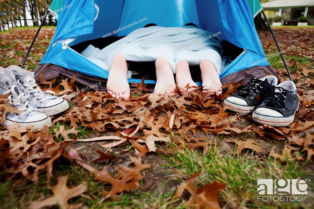 Stock Photo: Child's feet under a tent.