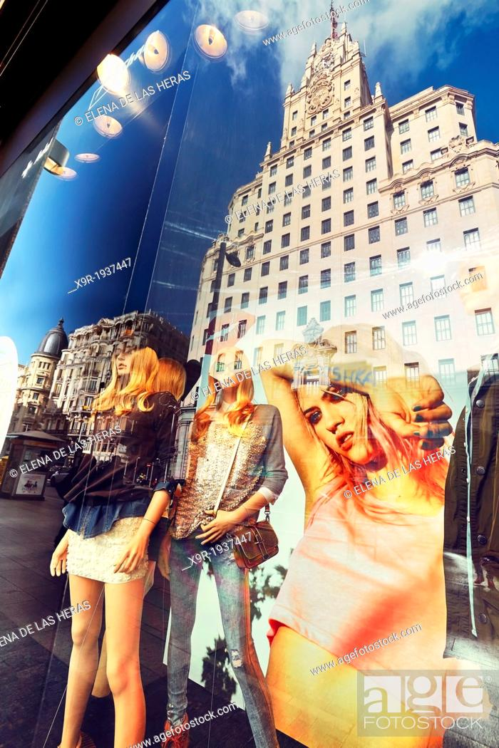 Stock Photo: Mannequins and reflections at a window shop in Callao square. Madrid. Spain.