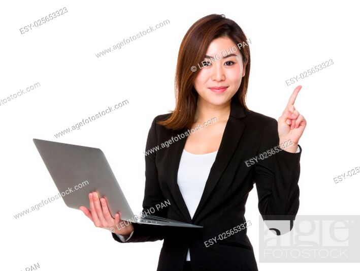 Stock Photo: Asian businesswoman use of laptop and finger point up.