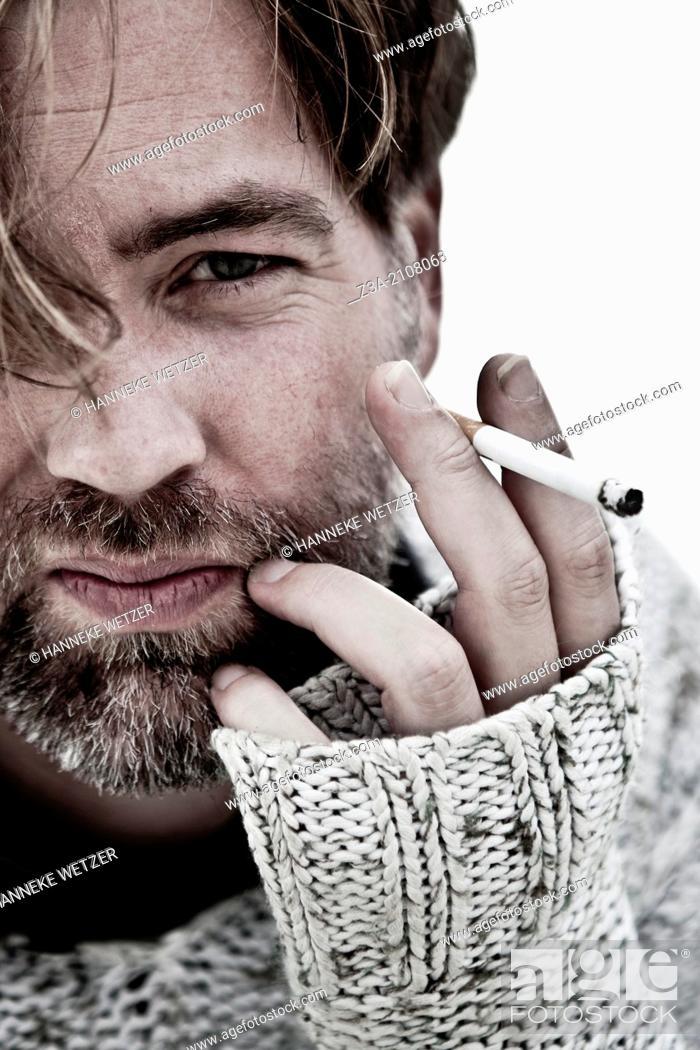Photo de stock: Handsome Man Smoking Cigarette.