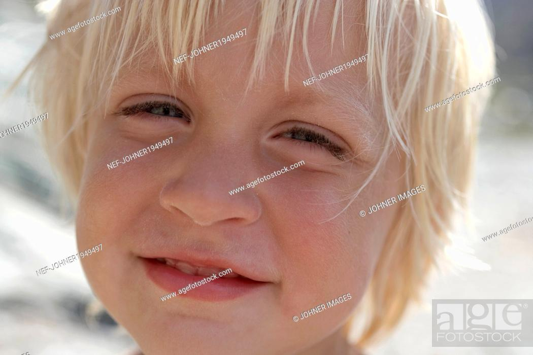 Stock Photo: Portrait of smiling boy.