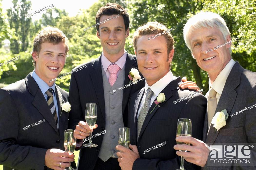 Stock Photo: Four men toasting at wedding portrait.