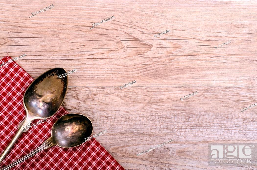 Zwei Alte Silberloffel Auf Karierten Tuch Und Einem Verwitterten Holz Stock Photo Picture And Rights Managed Image Pic Zon 4534625 Agefotostock