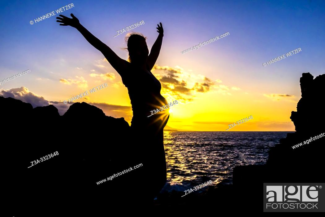 Stock Photo: Silhouet of a pregnant woman during sunset at the coastline of Las Palmas de Gran Canaria, Canary Islands.