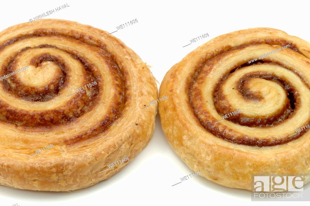 Stock Photo: 2 two Danish cinnamon whirl pastry on white background.
