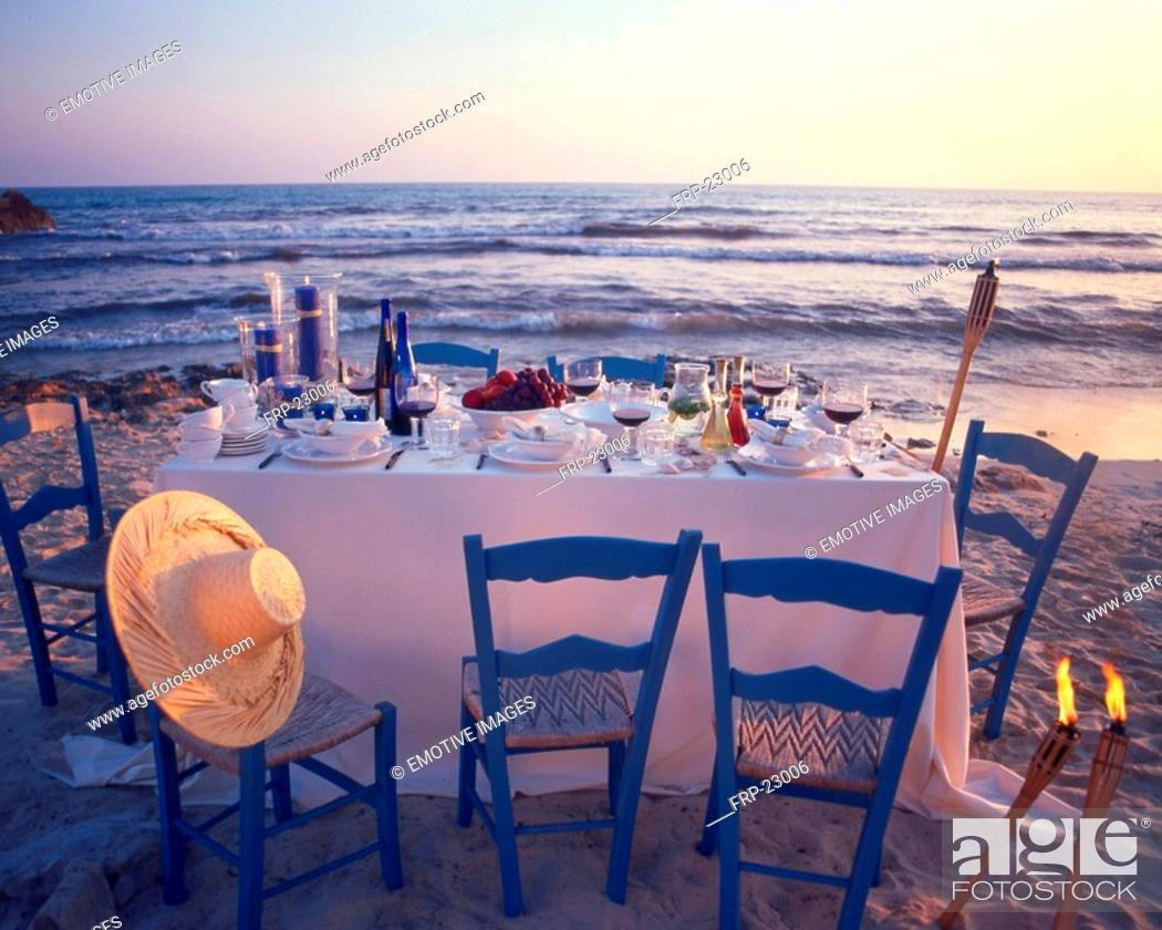 Stock Photo: Twilight dinner at the beach.