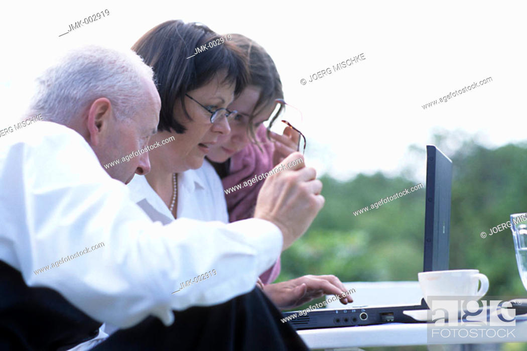 Stock Photo: A senior, businessman, father, grandfather, 45-50 50-55 55-60 years old, a woman, businesswoman, mother, 40-45 45-50 years old, and a girl, 5-10 years old.