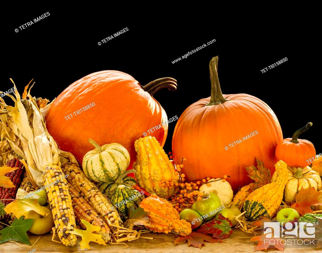 Stock Photo: Still life with pumpkins, apples and corn.