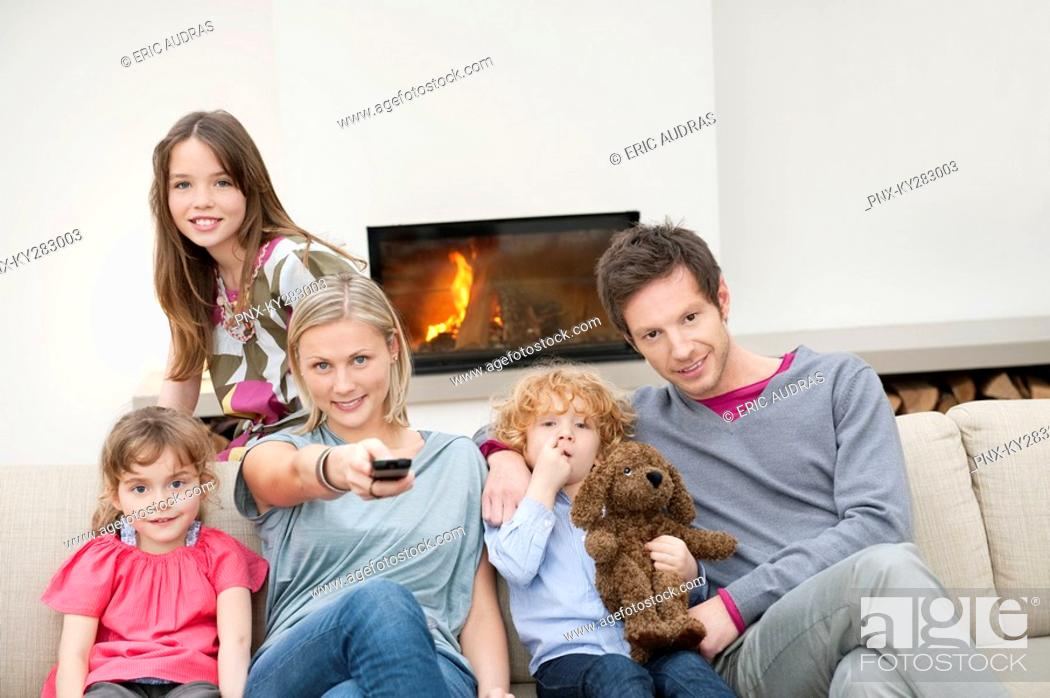 Stock Photo: Family watching television.