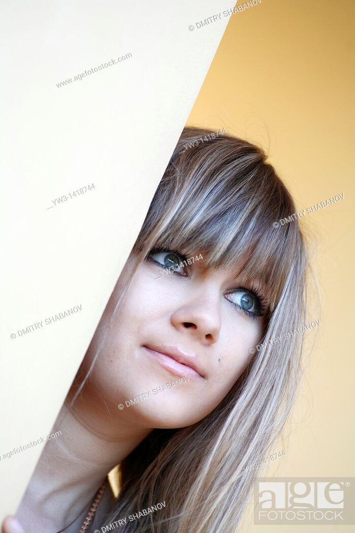 Stock Photo: Closeup portrait of a beautiful 20-25 years woman outdoors with blank expression.