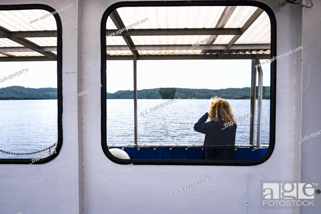 Stock Photo: Haverud, Sweden A woman passenger on a canal boat along the Dalsland Canal in western central Sweden.