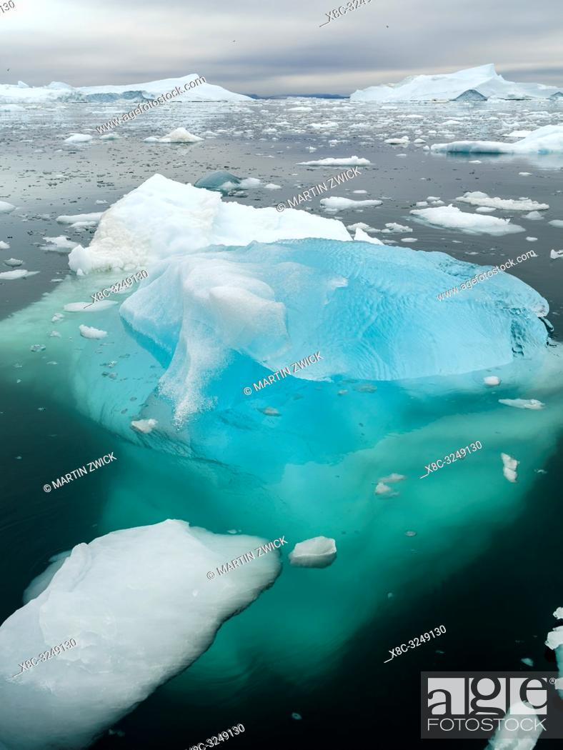 Stock Photo: Ilulissat Icefjord also called kangia or Ilulissat Kangerlua at Disko Bay. The icefjord is listed as UNESCO world heritage.