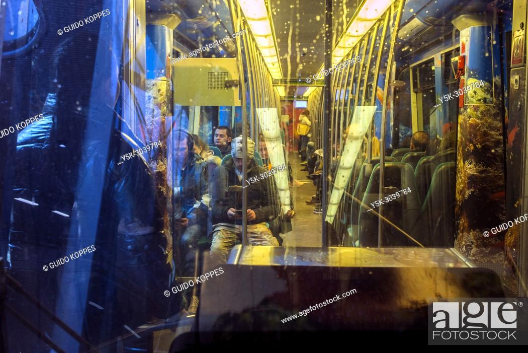 Stock Photo: Rotterdam, Netherlands. Subway Train Interior and Passengers commuting underground to their Destination.