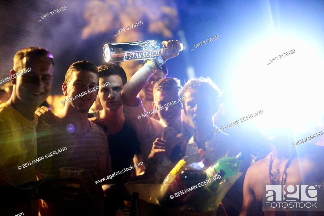 Stock Photo: party people holding Belvedere Vodka bottle at music festival Starbeach Chersonissos, Crete, Greece, at 06. August 2018.