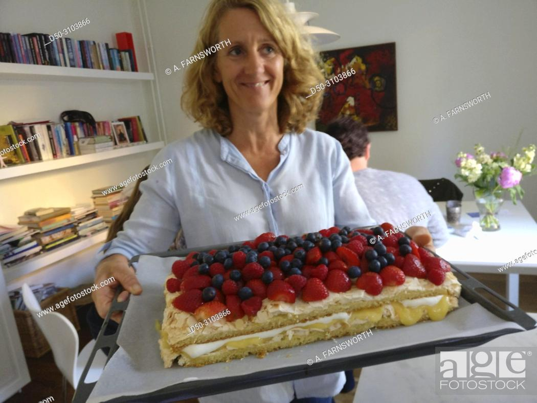 A 52 Year Old Woman Celebrates Her Birthday With Cake Berries