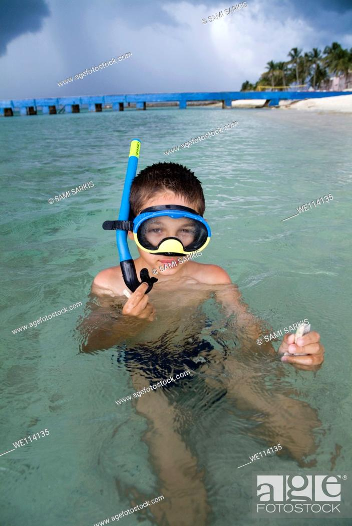 Stock Photo: Boy snorkelling in the tropical water at Maria la Gorda beach, Cuba.
