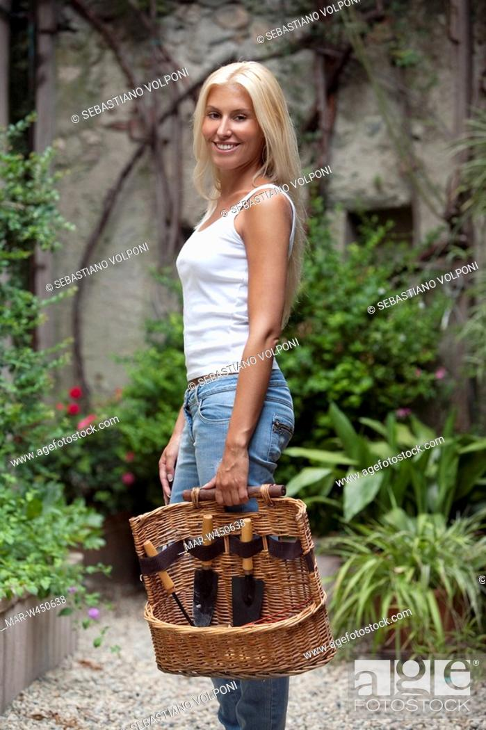 Stock Photo: woman doing gardening.