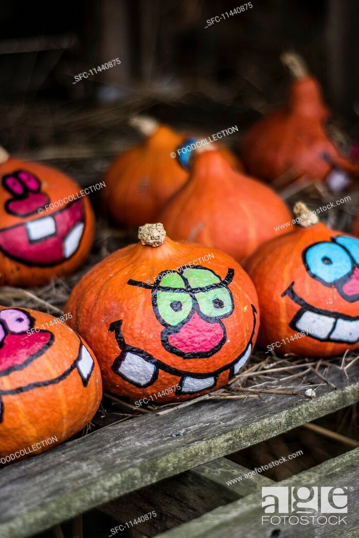 Stock Photo: Painted Halloween pumpkins on a farm.