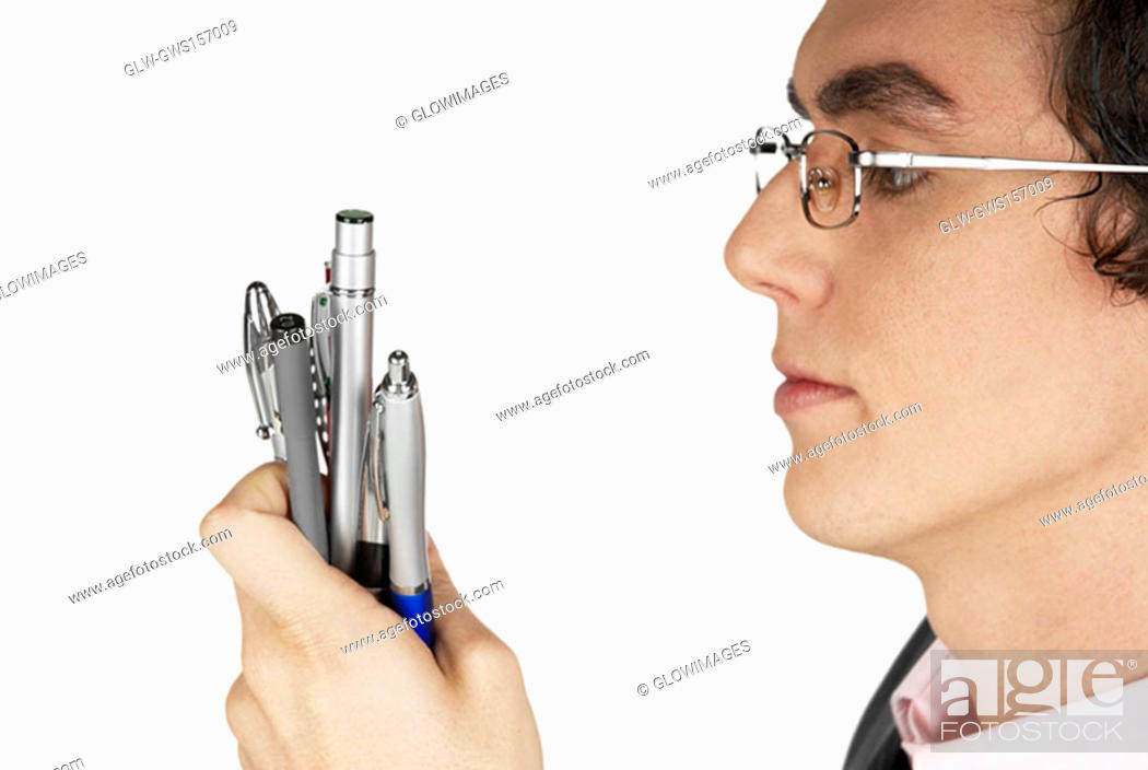 Stock Photo: Close-up of a businessman holding pens.