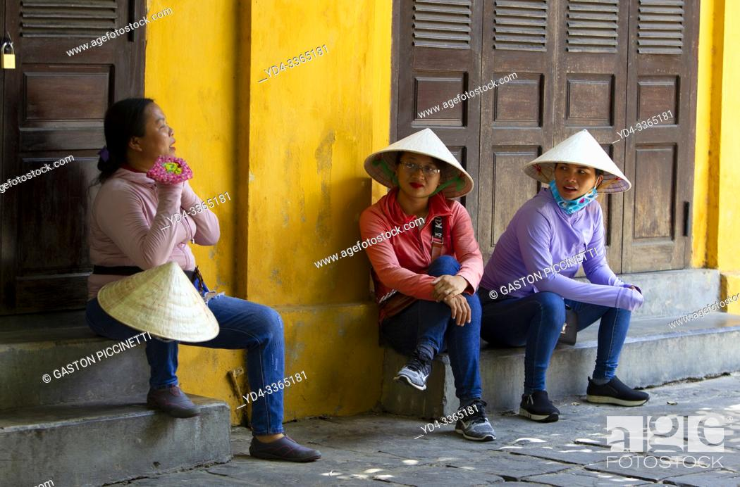 Stock Photo: People in the street. Hoi An Ancient Town, Quang Nam Province, Vietnam. .