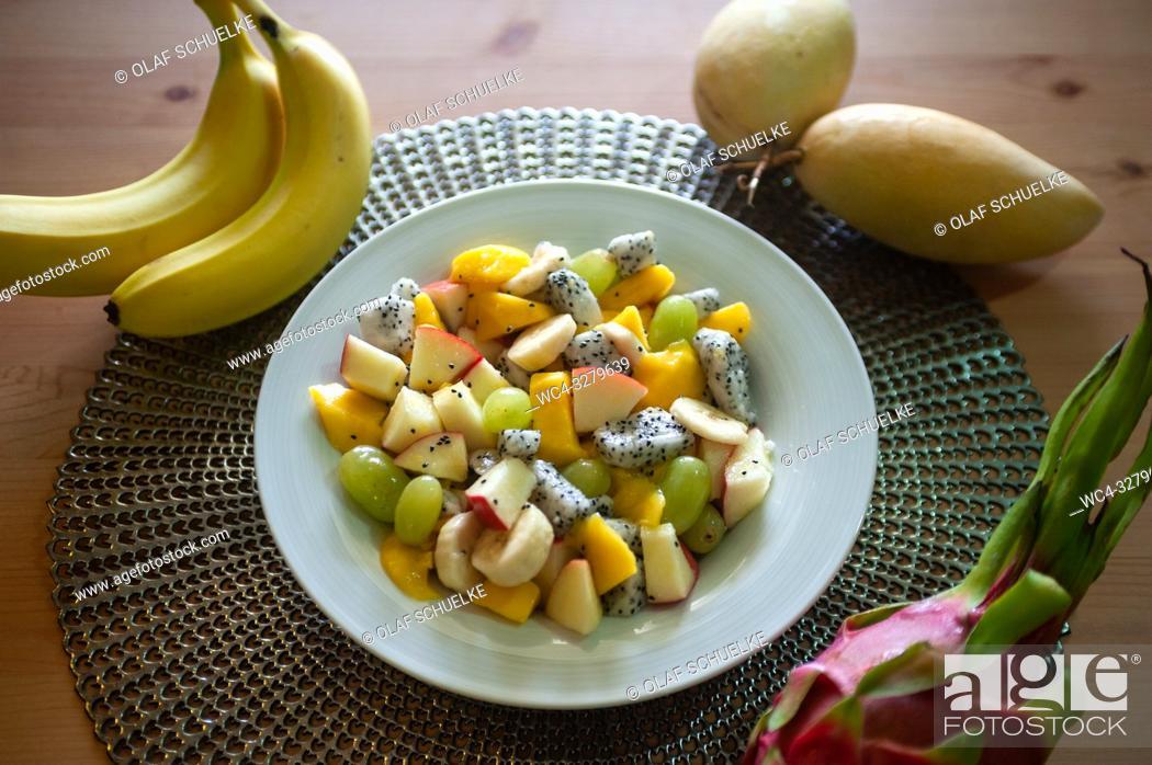 Stock Photo: Singapore, Republic of Singapore, Asia - Freshly prepared fruit salad with mango, banana, green grapes, apple and dragon fruit.