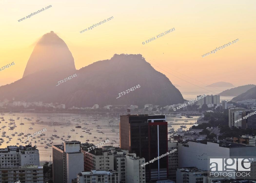 Stock Photo: Brazil, City of Rio de Janeiro, View over Botafogo Neighbourhood towards the Sugarloaf Mountain at sunrise.