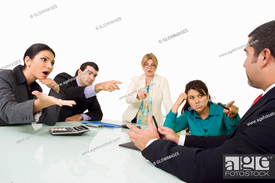 Stock Photo: Three businesswomen and a businessman blaming another businessman.