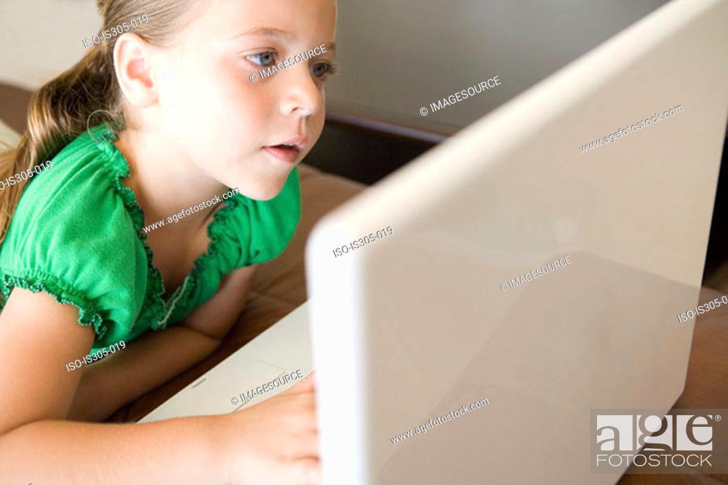 Stock Photo: Girl using laptop computer.
