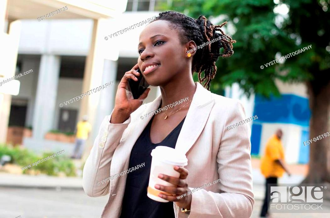 Stock Photo: Beautiful woman on the phone with a beautiful smile and holding a box of milk.