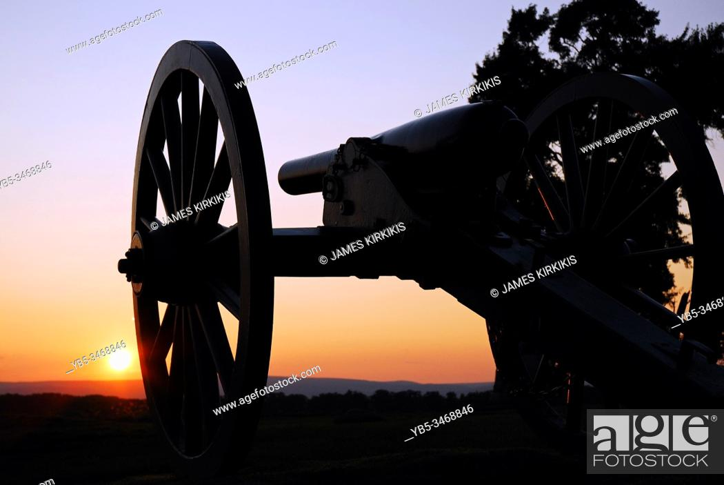 Stock Photo: The sun sets on still artillery at Gettysburg National Battlefield.