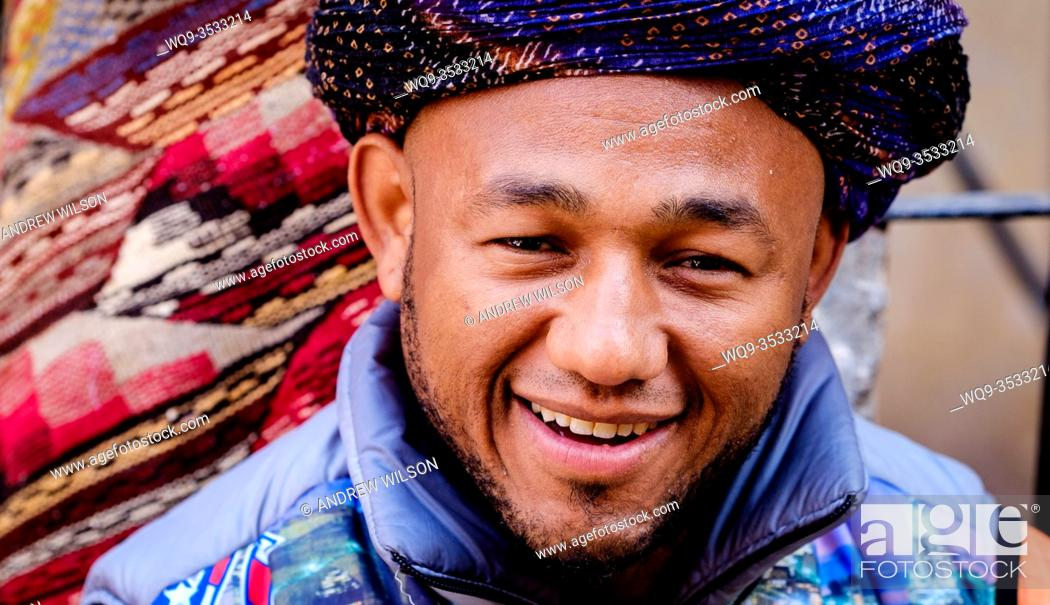 Stock Photo: A portrait of a Berber stallholder in the medina in Marrakech, Morocco, North Africa.