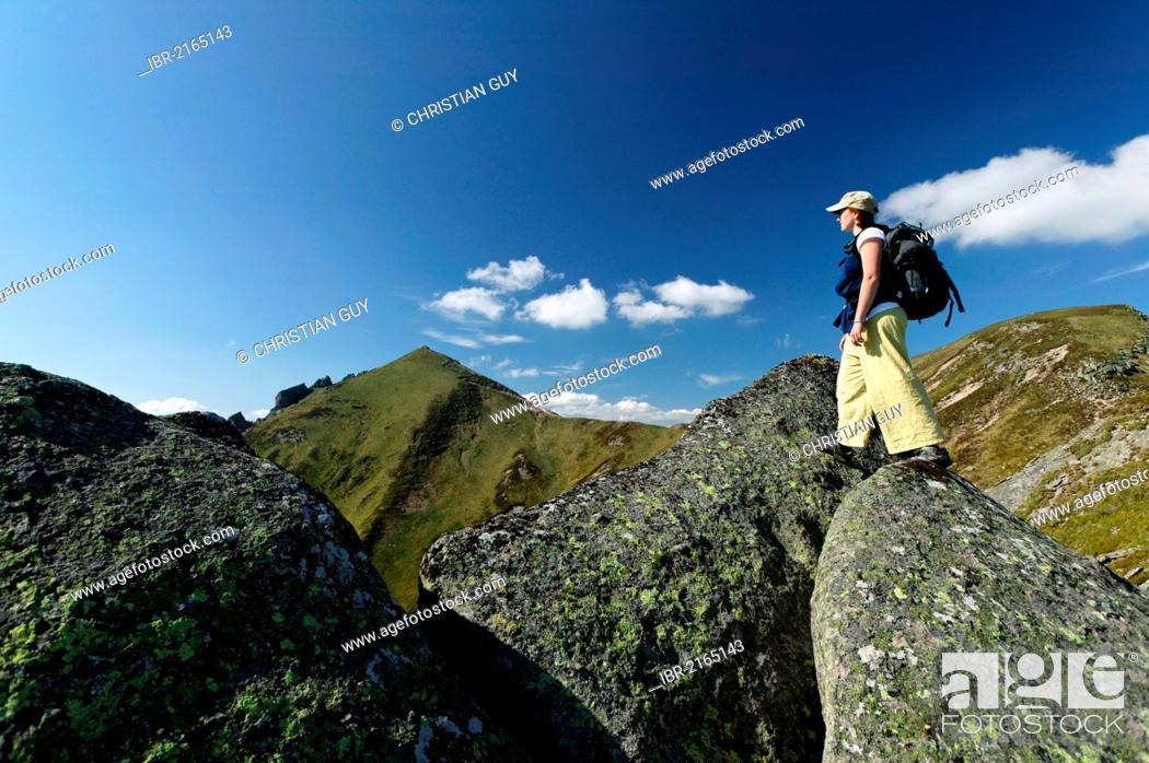 Stock Photo: Hiker in the Massif du Sancy, Parc Naturel Regional des Volcans d'Auvergne, Regional Nature Park of the Volcanoes of Auvergne, Monts Dore, Puy de Dome, France.