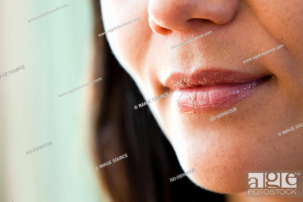 Stock Photo: Close up on female mouth.