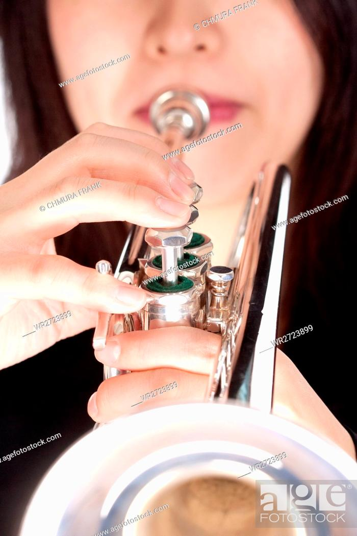 Stock Photo: Closeup of Trumpet Player Playing - Isolated on White.