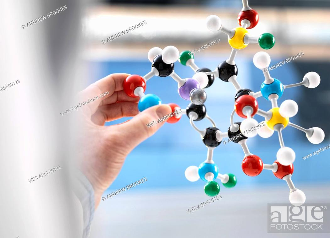 Stock Photo: Scientist holding a molecular model.