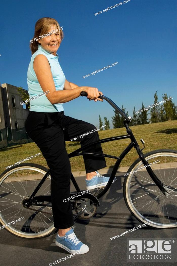 Stock Photo: Portrait of a senior woman cycling.