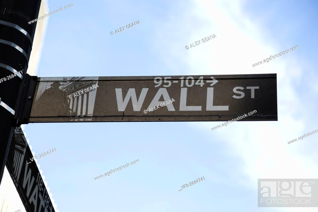 Stock Photo: The iconic street in New York has become the symbol for money, power and finance. The new signage was part of a recent move to update city streets.