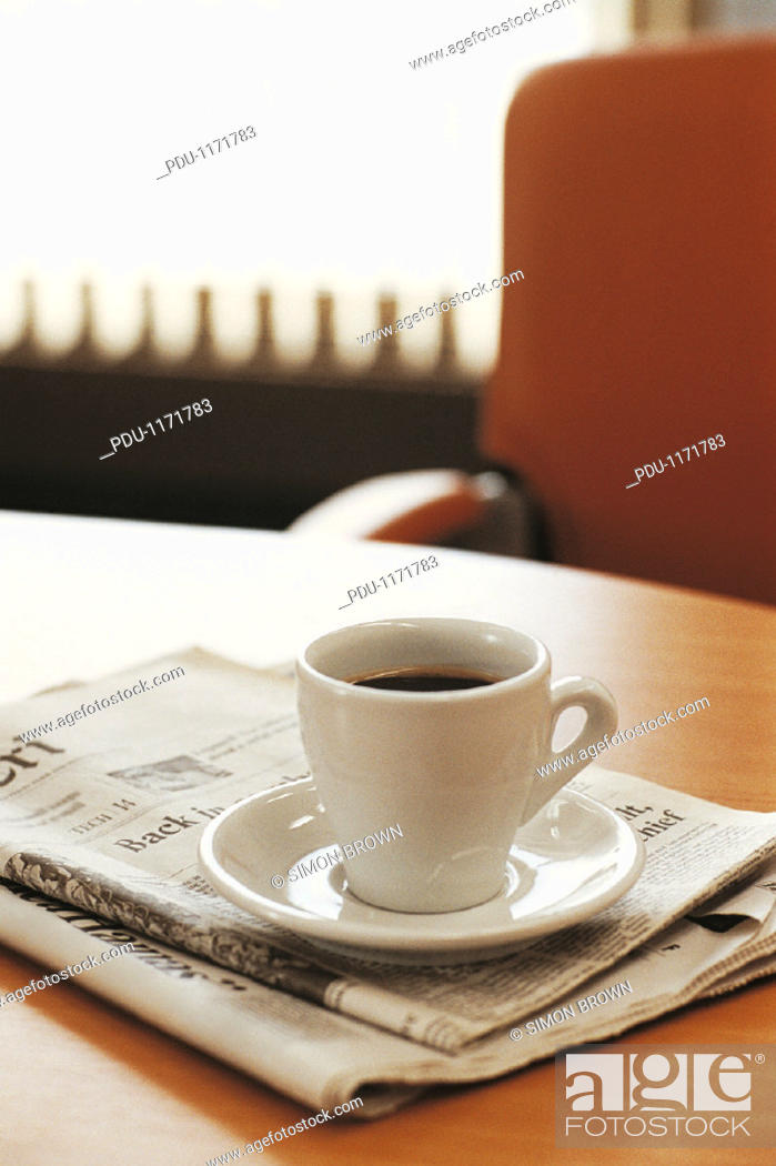 Stock Photo: Cup of Coffee With Folded Newspapers on a Desk.