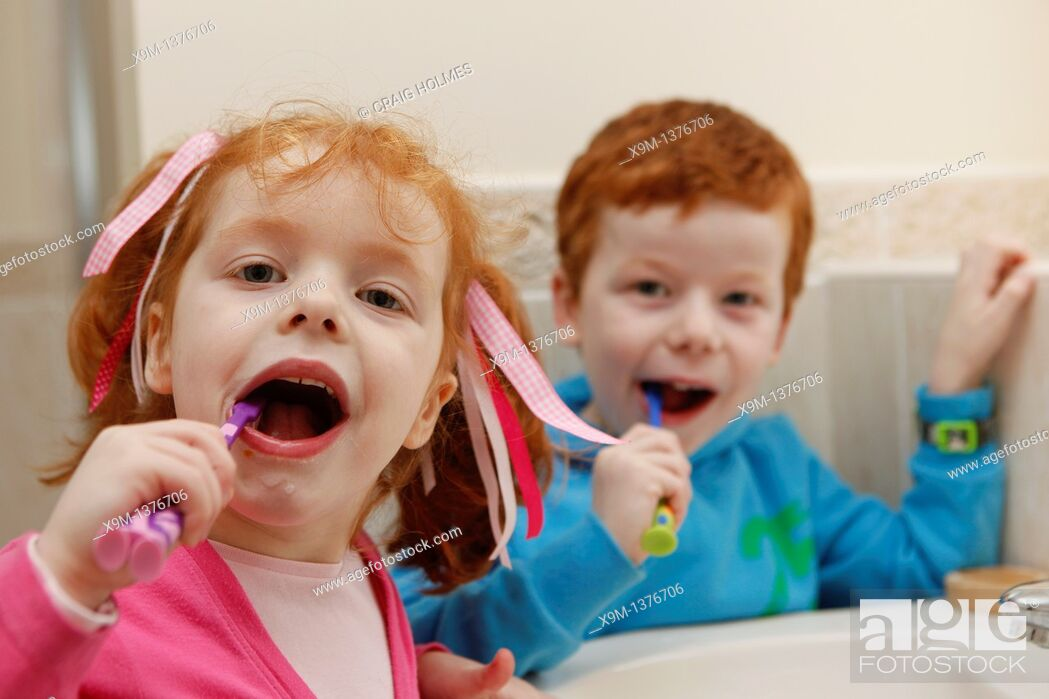 Stock Photo: Little boy and girl at home, brushing teeth in bathroom.