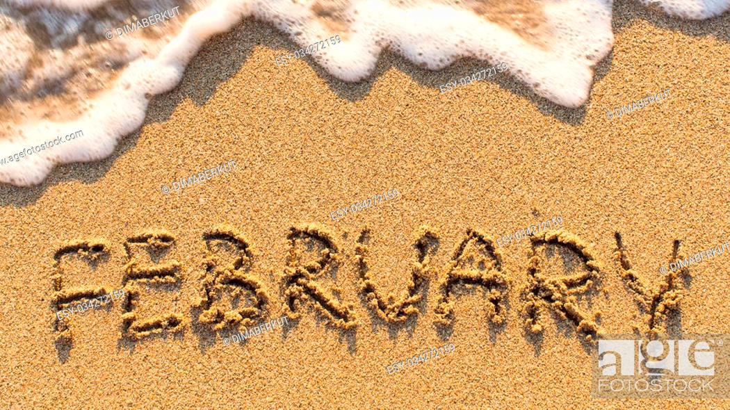 Stock Photo: Inscription FEBRUARY on a gentle beach sand with the soft wave (months of the year series).