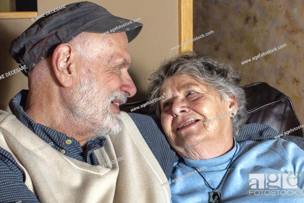 Stock Photo: An elderly couple in Washington in the United States, finds love and laughter everyday in life and in the art.