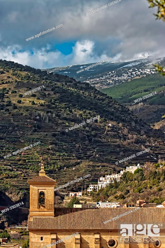 Stock Photo: Church roof in front of the Alpujarra's mountain in winter, Ohanes, Spain.