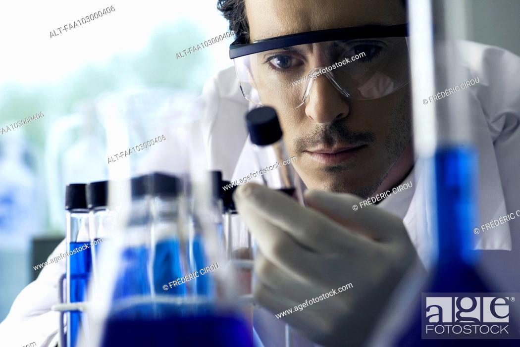Stock Photo: Lab technician conducting experiment in laboratory.