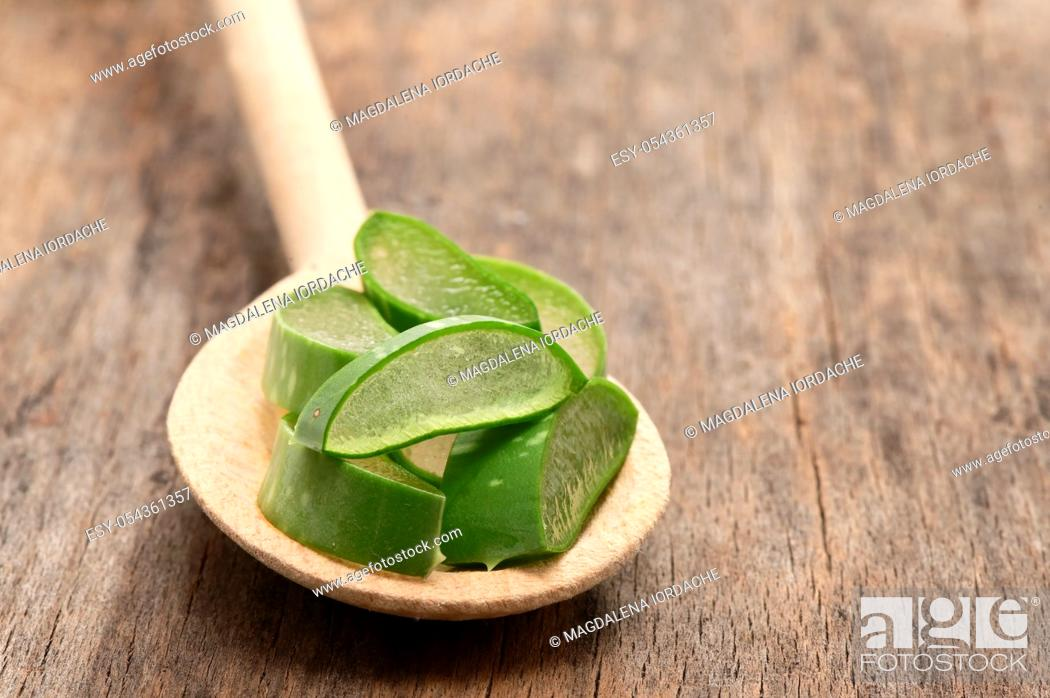 Stock Photo: Aloe Vera Slices And Spoon on Wooden Table.