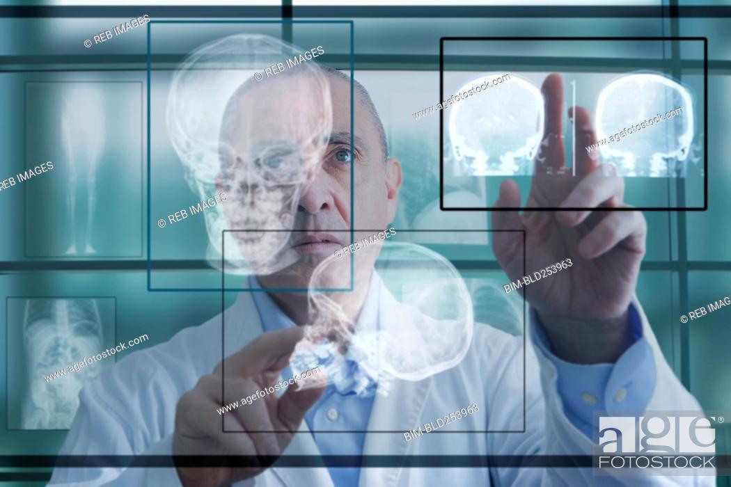 Stock Photo: Hispanic doctor using virtual computer screen.