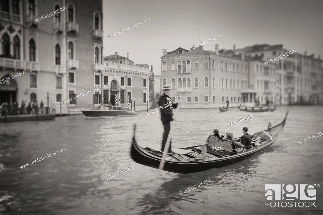 Stock Photo: Gondolier in Venice, Gran Canal, Italy.