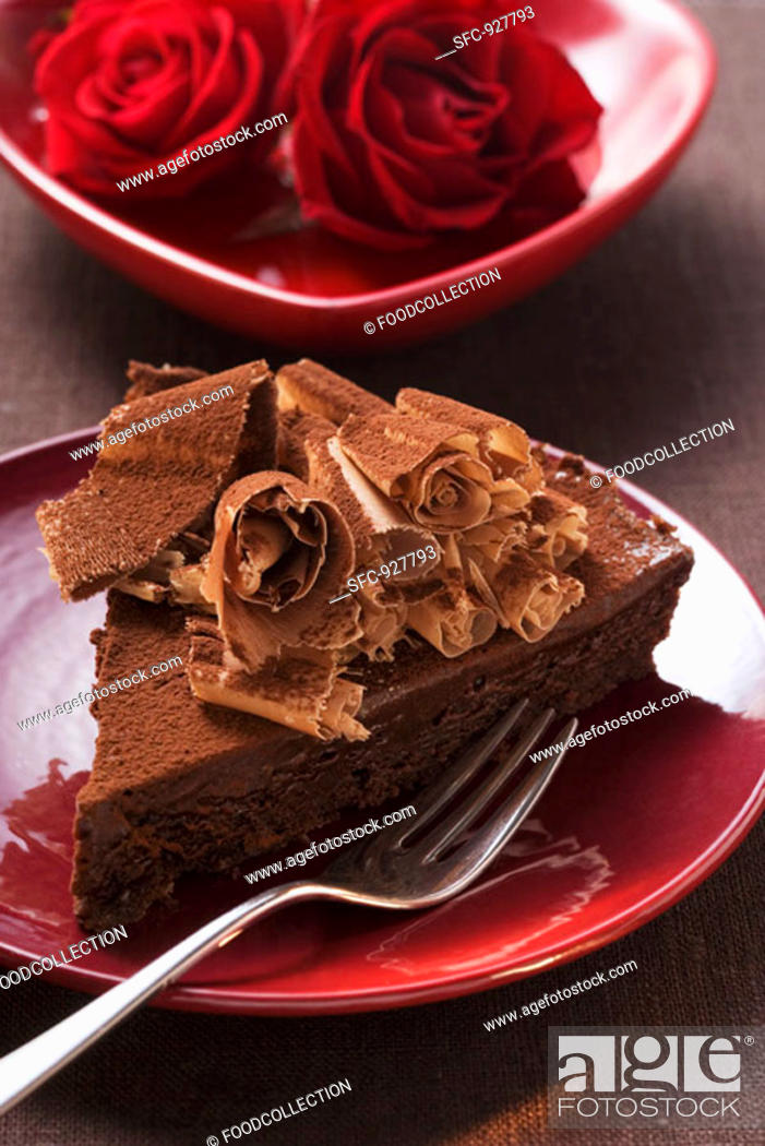 Stock Photo: Piece of chocolate cake with chocolate curls, red roses.